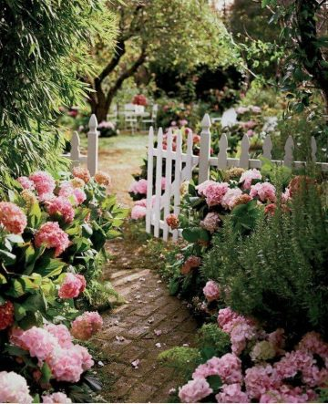 A garden walkway and white picket fence welcome you to the cottage. #house #ho...