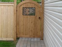 Arc Otty style pre-made door with Nuvo Iron gate insert, the warmth of the Hut hardwar...